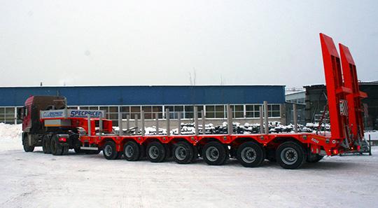Завод Specpricep представил модифицированный 7-осный низкорамный полуприцеп
